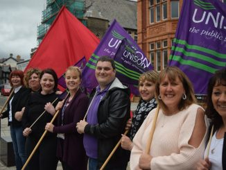 Activists from UNISON keeping the red flag flying in Merthyr Tydfil