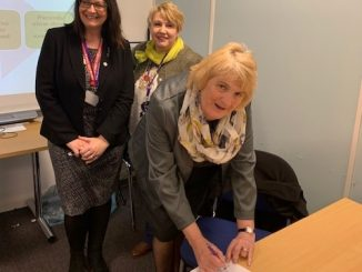 Cllr Maureen Webber signing guide